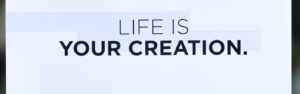 """Business card saying """"Life is Your Creation"""""""